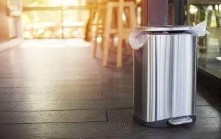 Metal trashcan sitting in a kitchen