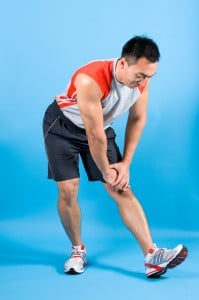 Man stretching his calves