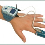 The WatchPat is worn on the wrist with a pulse-oxygen meter on the finger and a tube that monitors breathing is worn under the nose.