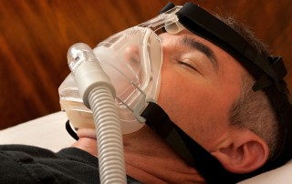 Middle aged man asleep with CPAP