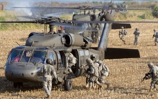 Army soldiers exiting helicopter