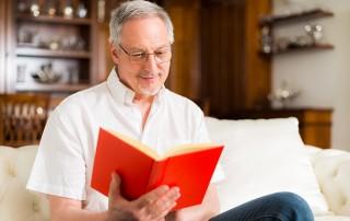 Mature man reading a book.