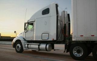 Trucker driving during sunset