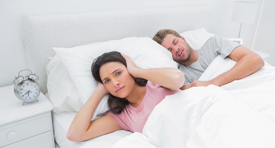 Husband keeping wife up with snoring