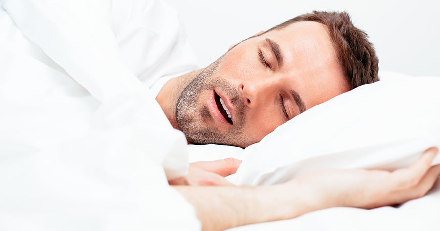 Close up of a man snoring