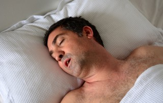Hairy man with large nose snores while sleeping