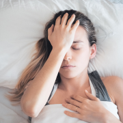 Woman in bed with headachec