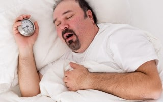 man yawning as he struggles to wake up