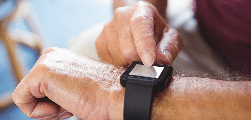 A man using an apple watch, which may help diagnose sleep apnea