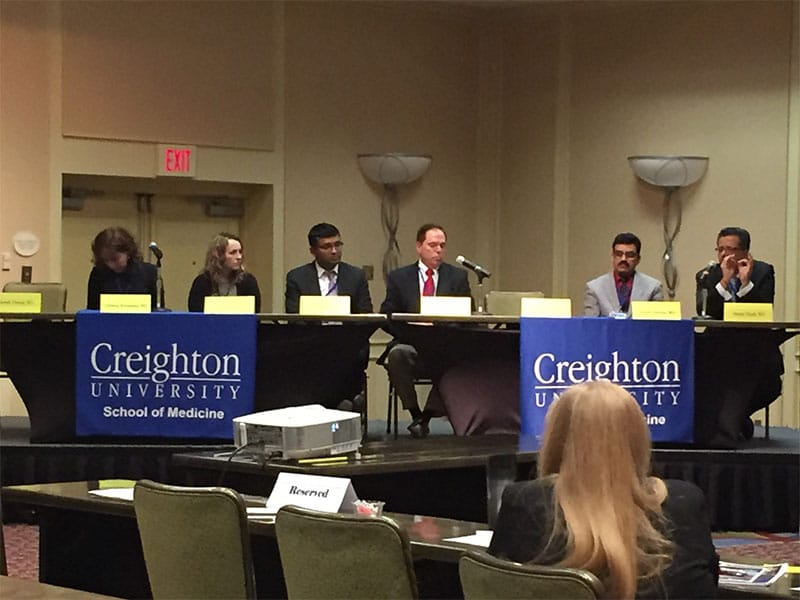 Dr. Roger Roubal with a group of Creighton University alum answering questions