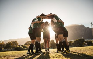 group of Young Athlete in a soccer huddle
