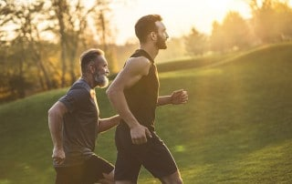 Two men run next to each other outside. An alternative to a CPAP machine, an Oral appliance, can help you continue to live your happy extended life.