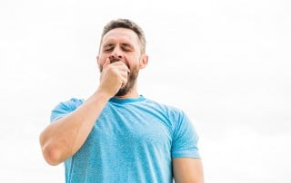 Man yawning at the gym. It's possible that his sleep apnea is limiting him from losing the extra weight he want to shed.