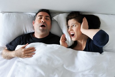 Woman suffering from her partner's secondhand snoring