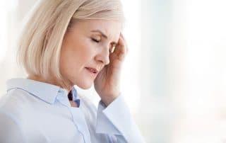 mature woman suffering from a migraine headache